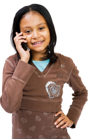 telecommunicating: Girl using a cell phone isolated over white