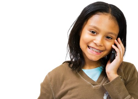 Latin American and Hispanic girl talking on a mobile phone isolated over white photo