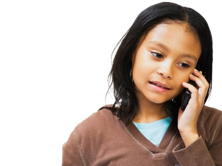 Girl talking on a mobile phone isolated over white photo