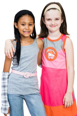 Two girls standing together isolated over white