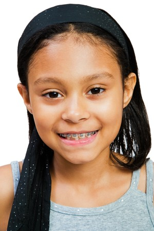 cute braces: Close-up of a girl smiling isolated over white