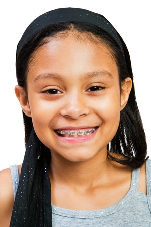 Portrait of a girl smiling isolated over white Stock Photo - 4568687