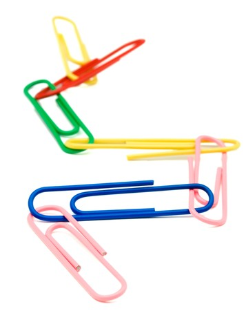 linked: Paper clips linked together isolated over white