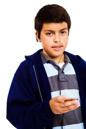 Retrato de un niño escuchando música aislado más de blanco Foto de archivo - 4700701