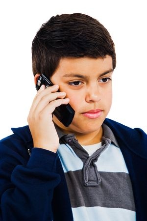 phoning: Boy talking on a mobile phone isolated over white