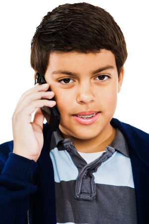 Caucasian boy using a mobile phone isolated over white photo