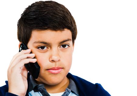 Caucasian boy talking on a mobile phone isolated over white