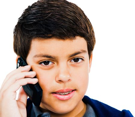 telecommunicating: Close-up of a boy using a mobile phone isolated over white