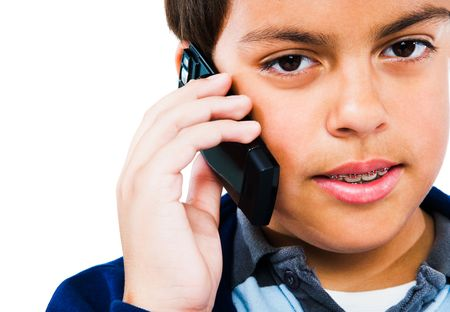 Child talking on a mobile phone isolated over white photo