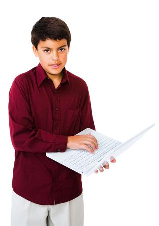 Child using a laptop isolated over white