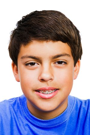preadolescent: Caucasian boy smiling isolated over white