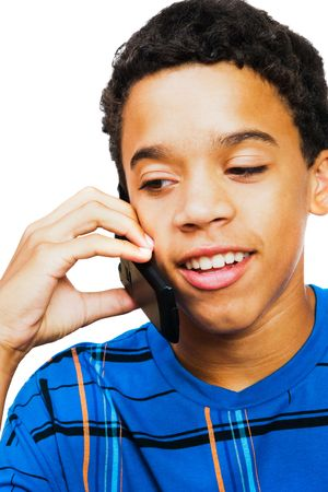 Teenage boy talking on a mobile phone isolated over white