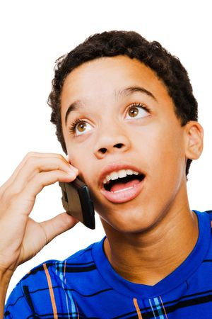 telecommunicating: Teenage boy on the phone isolated over white Stock Photo