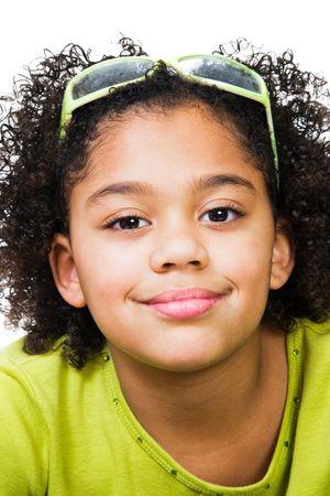 smirking: Girl wearing eyeglasses and smirking isolated over white Stock Photo