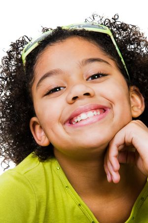 Portrait of a girl smiling isolated over white