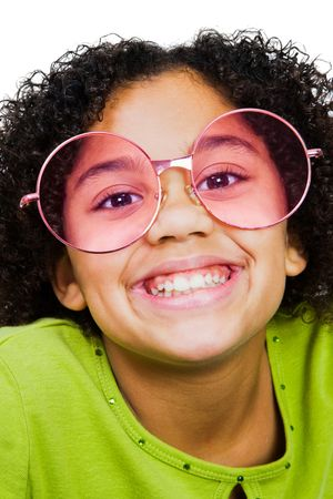 smirking: Girl wearing sunglasses and smirking isolated over white