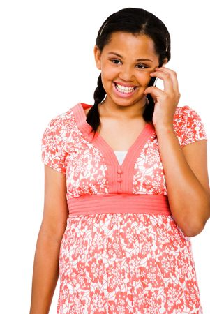 telecommunicating: Teenage girl talking on a mobile phone isolated over white