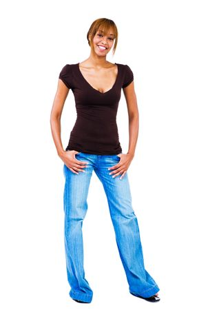 Young woman standing with her hands in her pockets isolated over white