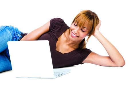 African young woman using a laptop isolated over white  photo