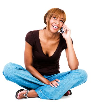 telecommunicating: Smiling woman talking on a mobile phone isolated over white  Stock Photo