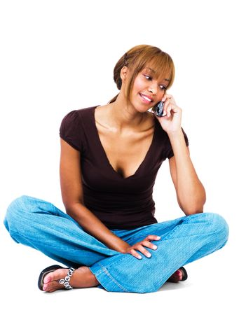 telecommunicating: Mixed race woman talking on a mobile phone isolated over white