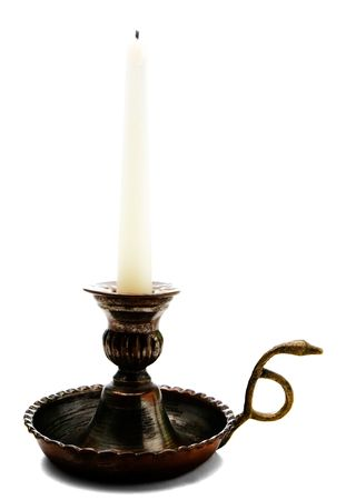 candle holder: Candle on a candle stick holder isolated over white Stock Photo