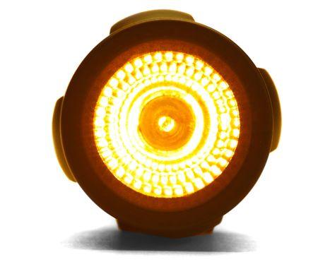 illuminated: Illuminated flashlight isolated over white