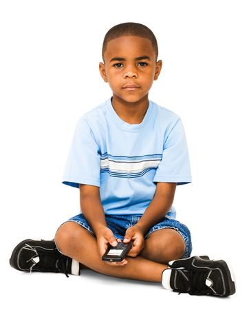 Portrait of a boy text messaging on a mobile phone isolated over white photo