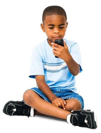 African boy text messaging on a mobile phone isolated over white photo