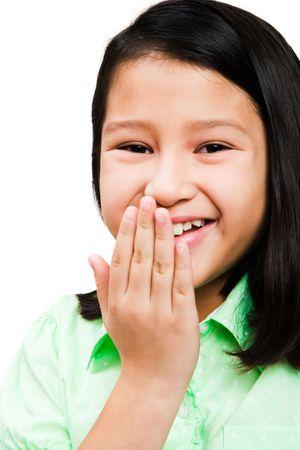 blissfulness: Smiling girl posing isolated over white