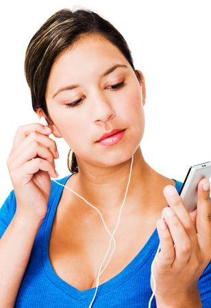 Woman listening to music on an mp3 player isolated over white