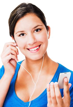Portrait of a woman listening to music on an mp3 player isolated over white photo