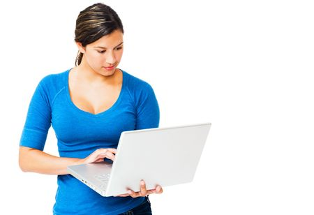 telecommunicating: Caucasian woman working on a laptop isolated over white