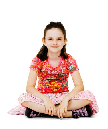 Smiling girl sitting on the floor isolated over white