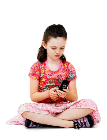 Girl text messaging on a mobile phone isolated over white photo
