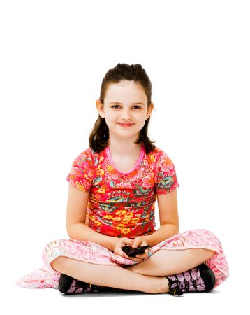 Happy girl text messaging on a mobile phone isolated over white photo