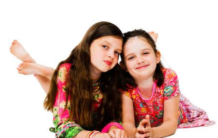 tween girl: Two girls smiling and posing isolated over white