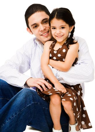 Brother hugging his sister and smiling isolated over white