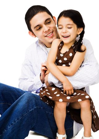 Sister sitting with her brother and smiling isolated over white photo