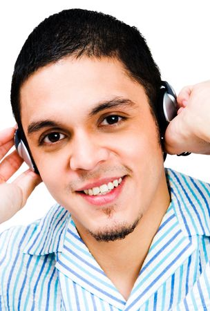 Latin American man listening to headphones isolated over white photo
