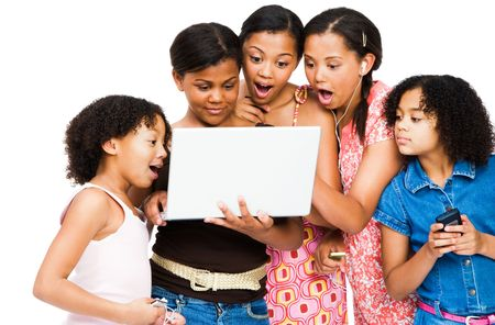 telecommunicating: Shocked friends using a laptop isolated over white Stock Photo