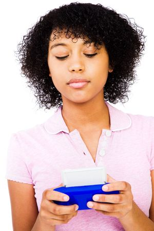 Caucasian teenage girl text messaging isolated over white photo