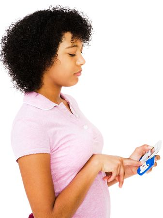 telecommunicating: Teenage girl text messaging on a mobile phone isolated over white Stock Photo