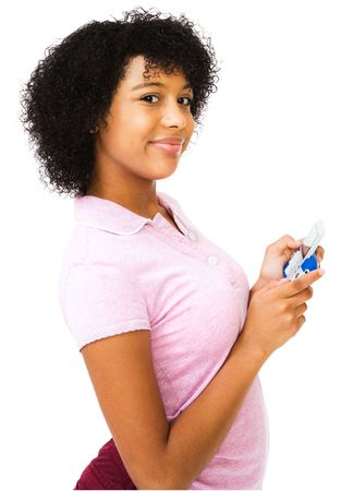 African teenage girl text messaging on a mobile phone isolated over white photo