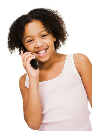 telecommunicating: Girl talking on a mobile phone isolated over white