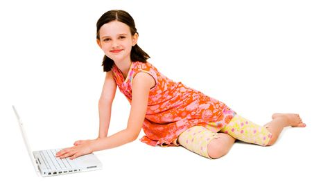 telecommunicating: Portrait of a girl using a laptop and posing isolated over white