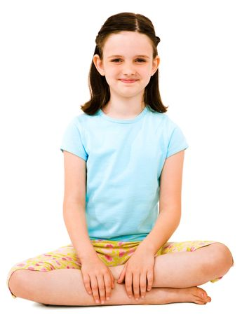 Caucasian girl sitting and smiling isolated over white Stock Photo