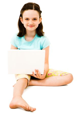 Portrait of a girl using a laptop and smiling isolated over white Фото со стока