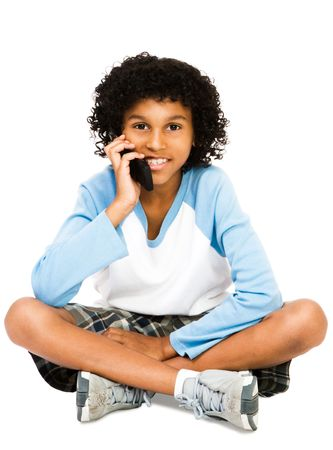 Boy using a mobile phone isolated over white photo