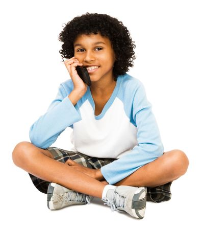 Boy talking on the phone isolated over white Stock Photo